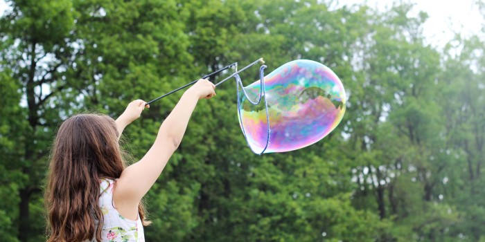 Child playing with bubble